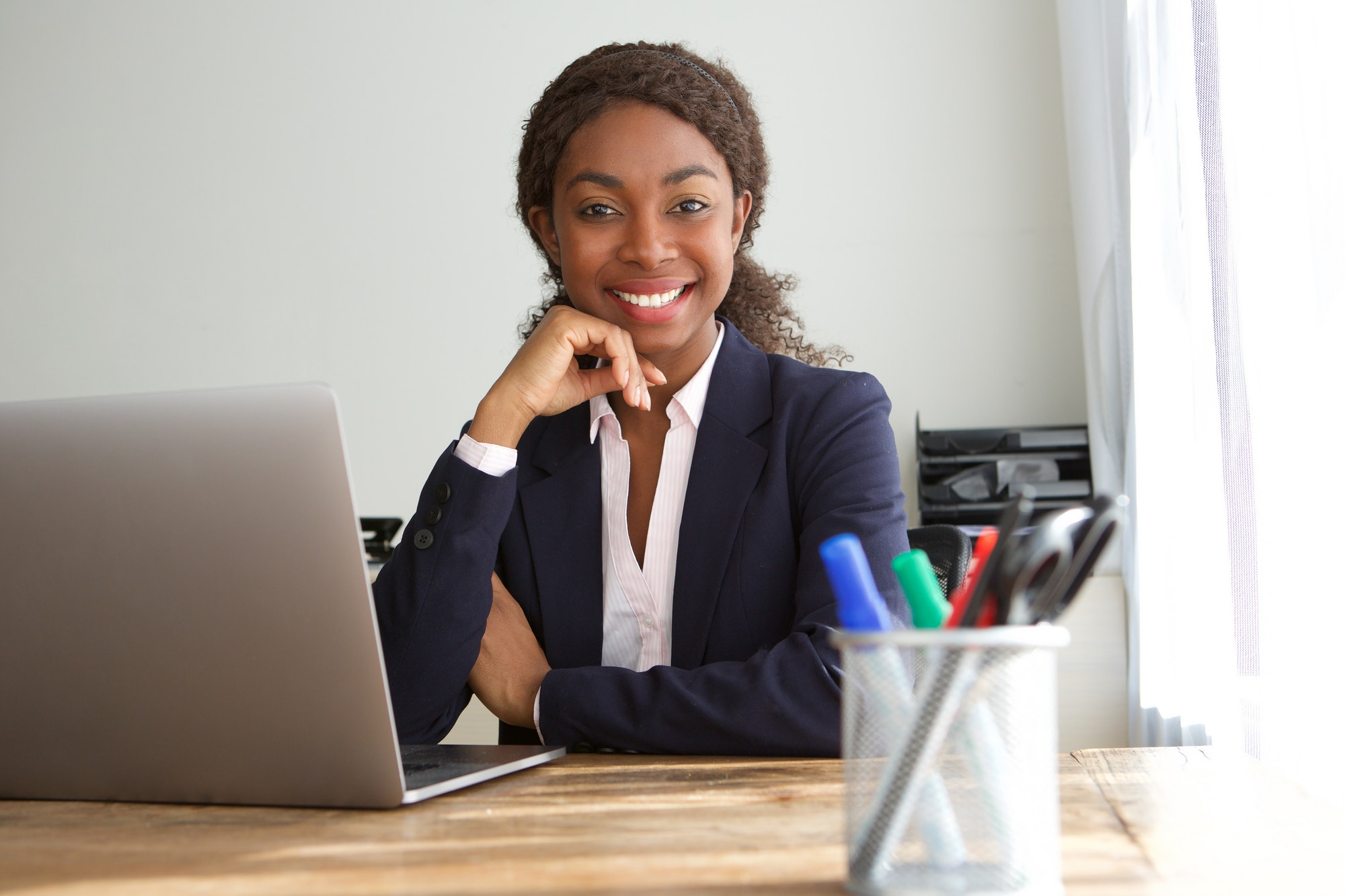 young black businesswoman sitting at office desk